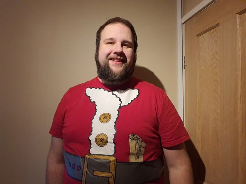 Photo of Ian dressed as Santa